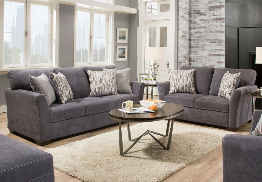 Simmons Upholstery Pacific Steel Blue Sofa and Loveseat With Highway Driftwood and Cruze Driftwood Pillows